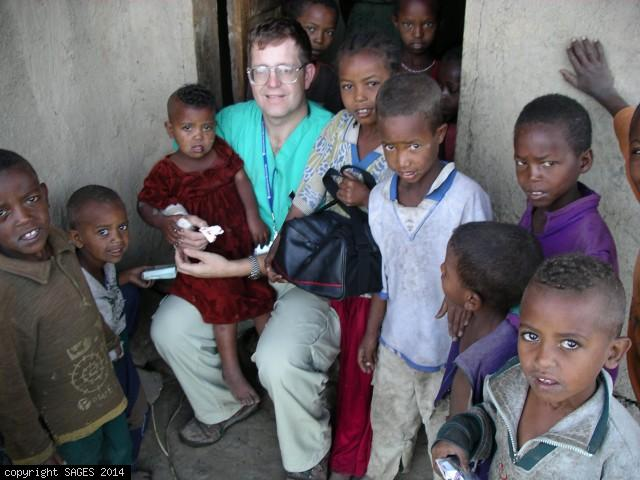 Consoling child before Ethiopia village clinic